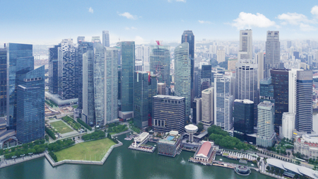 Beautiful aerial view of skyscrapers at waterfront. Shot at Marina Bay, Singapore
