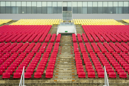 Singapore. February 15, 2018: rows of red and yellow bleachers in the football stadium Redactioneel