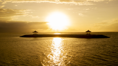 Picture of beautiful sunset with bright golden sunbeam at Sanur beach in Bali, Indonesia Stock Photo