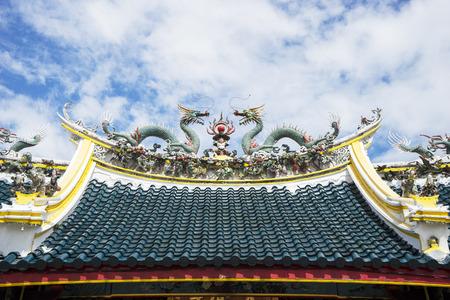 JAKARTA - INDONESIA, APRIL 28, 2018: Beautiful dragon statues above roof of Vihara Tay Kak Sie Editorial