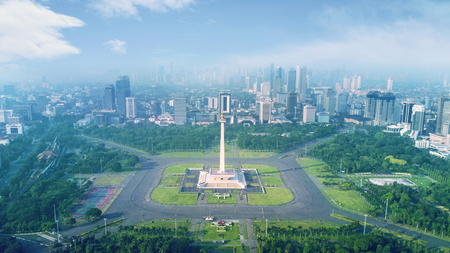 Beautiful landscape of National Monument with mist at morning time in Jakarta, Indonesia