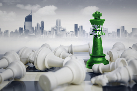 Image of a chess king with Saudi Arabia flag defeating white chess pieces. Shot with modern city