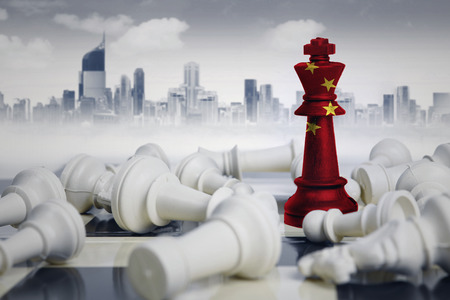 Image of a chess king with China flag defeating white chess pieces. Shot with modern city 스톡 콘텐츠