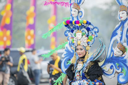 JEMBER - Indonesia. May 21, 2018: Beautiful carnival model on annual parade in Jember Festival Carnaval