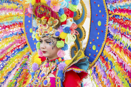 JEMBER - Indonesia. May 21, 2018: Colorful costumes worn by a participant at annual parade in Jember Festival Carnaval