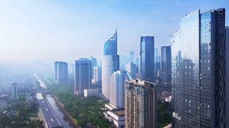 Aerial view of Jakarta cityscape with modern high buildings. Shot in the misty morning
