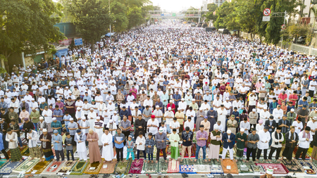 JAKARTA - Indonesia. JUNE 15, 2018: Thousands of muslims praying together on Eid-ul Fitr day in East Jakarta, Indonesia.
