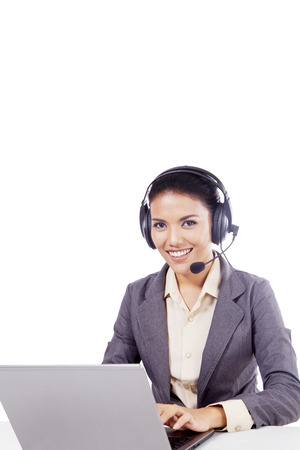 Beautiful call center operator working with headphone and laptop, isolated on white background