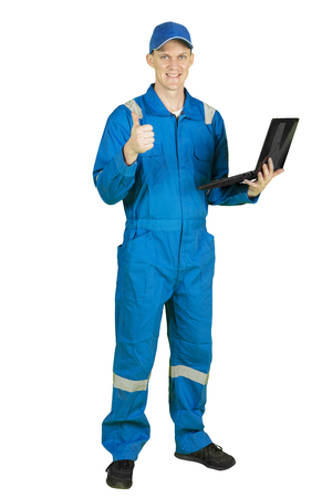 American male mechanic showing OK sign with his thumb while using a laptop computer, isolated on white background Stock Photo