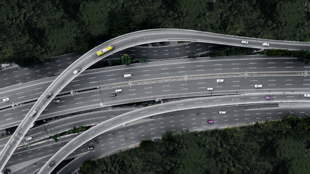 Aerial view of cars crossing interchange overpass in the downtown Jakarta, Indonesia