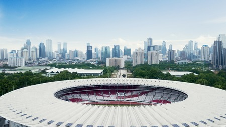 JAKARTA - Indonesia. August 13, 2018: Beautiful scenery of Senayan Stadium under blue sky with Jakarta cityscape background