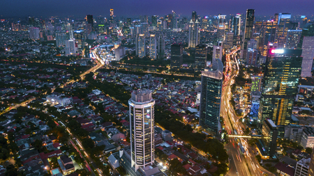 JAKARTA - Indonesia. August 31, 2018: Beautiful night scenery of Jakarta cityscape with lights glowing on highway and skyscrapers