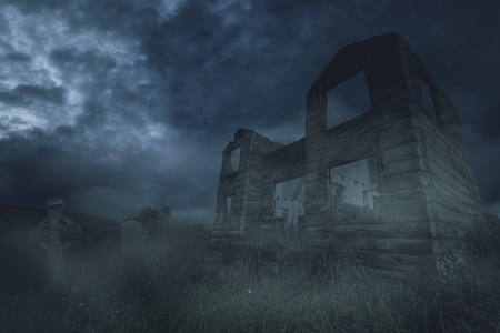 Image of abandoned house near the scary grave at night time