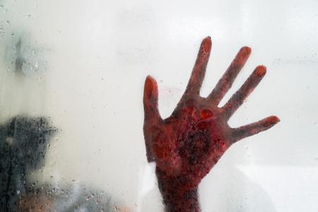 Halloween horror concept. Picture of horrible hand behind glass bathroom window Standard-Bild