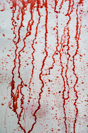 Image of fresh human blood splotching on the wall. Concept of Halloween horror