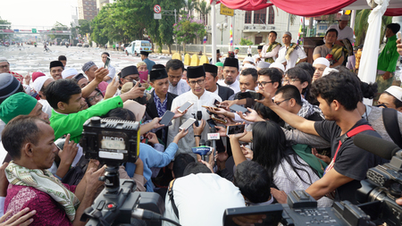 JAKARTA - Indonesia. September 18, 2018: Journalists interviewing Mr. Sandiaga Uno after praying on Eid Al Adha day Editorial