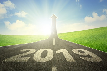 Image of empty road with numbers 2019 toward an upward arrow on the end of road