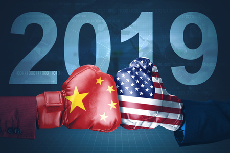 Concept of trade war between USA and China. Two hands wearing boxing gloves with number 2019 background