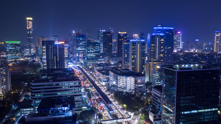 JAKARTA - Indonesia. October 12, 2018: Beautiful night view of Jakarta city with skyscrapers and light trails on highway