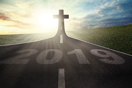 Image of number 2019 toward Cross symbol on the end road with sunrise