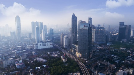 JAKARTA - Indonesia. October 12, 2018: Aerial view of skyscraper buildings with misty morning in Jakarta, Indonesia Редакционное