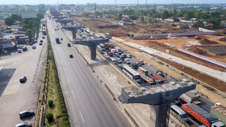 West Java, Indonesia - October 10, 2018: Construction site of Jakarta-Cikampek elevated toll road project with traffic jam on the highway