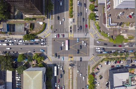 JAKARTA - Indonesia. Top view of vehicle on crossroads with crosswalk in Jakarta city
