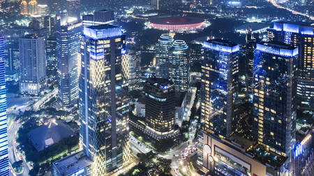 JAKARTA - Indonesia. December 12, 2018: Aerial view of high buildings with glowing lights at night in Jakarta city