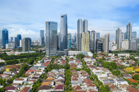 JAKARTA - Indonesia. January 03, 2019: Aerial view of modern residential with skyscrapers in Jakarta downtown