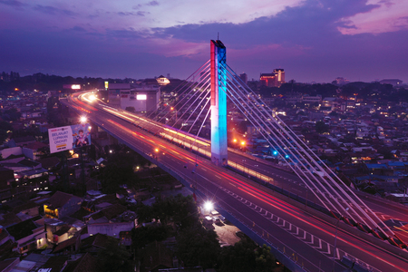 Bandung - Indonesia. January 03, 2019: Aerial view of beautiful light trails on a Pasupati bridge at evening time
