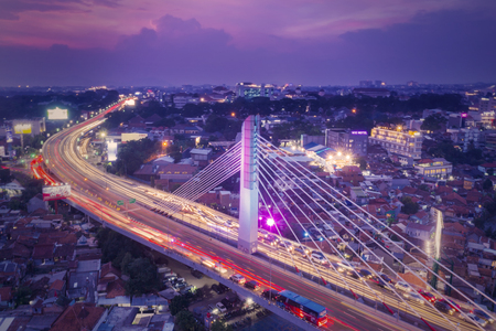 Bandung - Indonesia. January 03, 2019: Aerial view of glowing Pasupati overpass at evening in Bandung city
