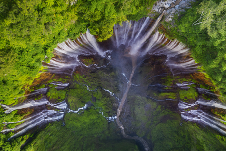Aerial view of wonderful Tumpak Sewu waterfall in the tropical forest at Lumajang, Indonesia