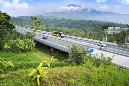 Ungaran, Central Java, Indonesia - January 18, 2019: Aerial view of Trans-Java Tollway bridge with mountain view at Semarang, Central Java, Indonesia 報道画像