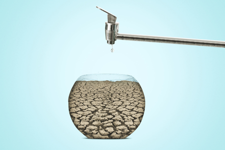 Image of dry soil shaped aquarium with faucet. Concept of global warming