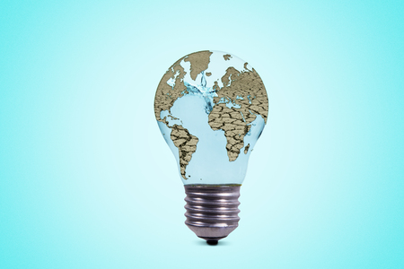 Concept of save water. Close up of dry world map shaped a light bulb with blue background
