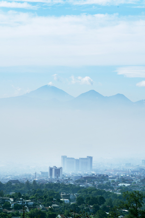 Beautiful aerial cityscape on misty morning in Bandung city, West Java, Indonesia