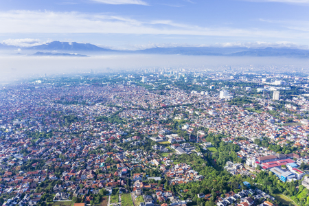 Beautiful aerial view of Bandung cityscape on misty morning, West Java, Indonesia