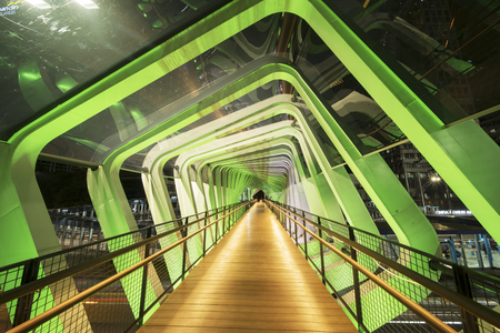 Beautiful interior of new GBK pedestrian bridge above Sudirman highway in Jakarta city, Indonesia Редакционное
