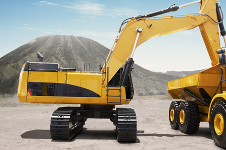 Image of excavator loading soil into a truck at the construction site Stockfoto