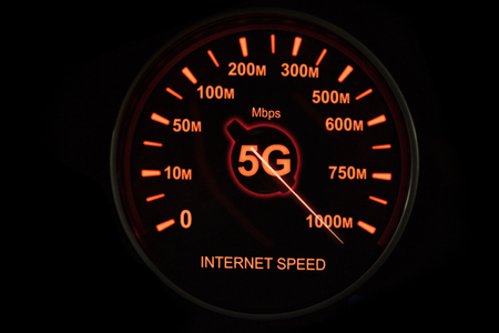 Close up of 5G network speedometer showing Mbps numbers in high speed. Internet speed concept