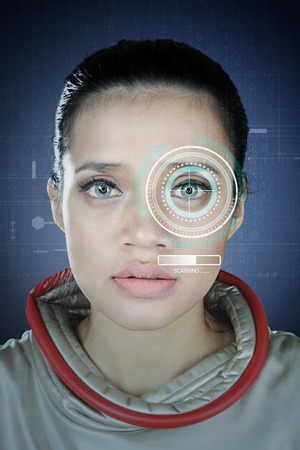 Closeup of beautiful young woman scanning her eye on a eyes identification technology system