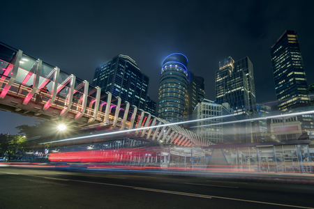 Image of beautiful new pedestrian bridge with skyscrapers at night time in Jakarta city Foto de archivo