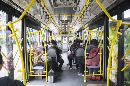 JAKARTA - Indonesia. March 20, 2019: Interior of Transjakarta bus with passengers