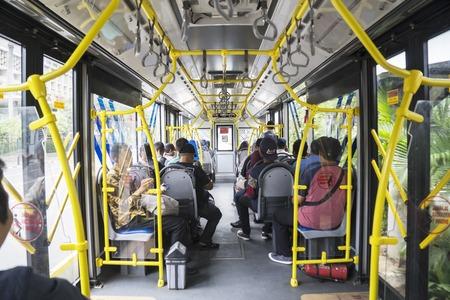 JAKARTA - Indonesia. March 20, 2019: Interior of Transjakarta bus with passengers Editorial