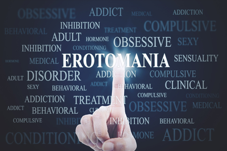 Close up of unknown man hands pressing erotomania word on the virtual screen Reklamní fotografie