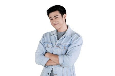 Portrait of a smiling young man with confident pose in the studio, isolated on white background