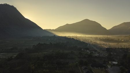 Beautiful scenery of misty morning above Sembalun village near Rinjani mountain in Lombok, Indonesia
