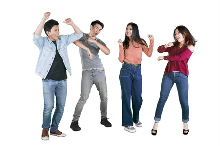 Picture of happy young people dancing together by celebrating their success in the studio 版權商用圖片