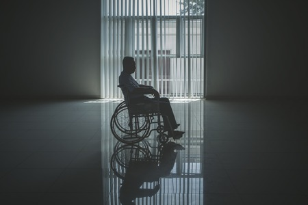 Picture of lonely elderly man looks sad in the retirement home while sitting in the wheelchair Banque d'images - 122964419
