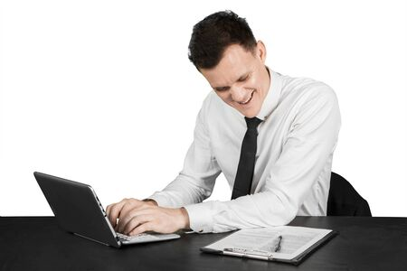 American businessman doing paperwork and typing on laptop, isolated on white background